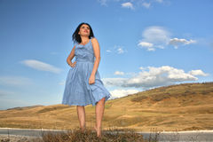 Woman standing by the road Stock Images