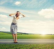 Woman standing on the road and screaming Royalty Free Stock Photography