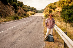 Woman standing by the road Stock Image