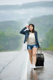 Woman standing on road Royalty Free Stock Image
