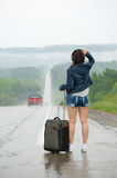 Woman standing on road Stock Images