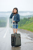Woman standing on road Stock Photography