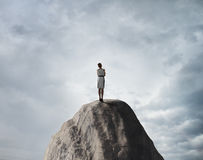 Woman standing on rock Stock Photography