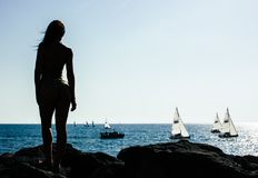 Woman Standing on Rock With Sailing Boats on Sea Stock Photography