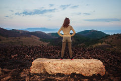 Woman standing on a rock Stock Image