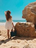 Woman Standing Beside Rocks Near Beach stock photos
