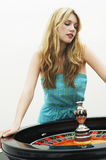 Woman Standing At Roulette Wheel Royalty Free Stock Photos