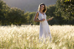 Woman standing in rural field stock image
