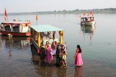Woman standing on sacred river Narmada at Maheshwar Royalty Free Stock Images