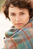 Woman Standing In Sand Dunes Wrapped In Blanket Stock Photography