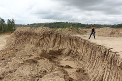 Woman standing at a sandpit in cloudy day Royalty Free Stock Images
