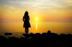 Woman  standing on a sea coast Stock Photos