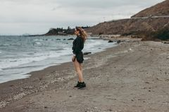 Woman Standing on Seashore royalty free stock images