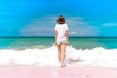 Woman Standing on Seashore Stock Photos