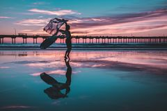 Woman Standing on Shallow Water Stock Photos