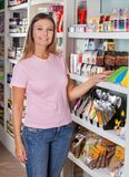 Woman Standing By Shelf In Grocery Store Royalty Free Stock Photography