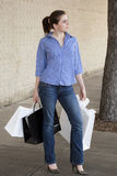 Woman standing with shopping bags at mall Royalty Free Stock Photography
