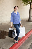 Woman standing with shopping bags at mall Royalty Free Stock Photos