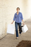 Woman standing with shopping bags at mall Royalty Free Stock Images