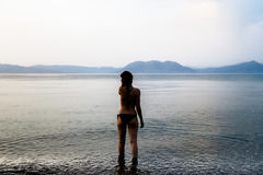 Woman Standing on Shore Wearing a Black Bikini during Daytime Stock Photography