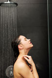 Woman standing at the shower. Stock Photography