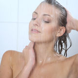 Woman standing at the shower Stock Photo