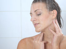 Woman standing at the shower Royalty Free Stock Images