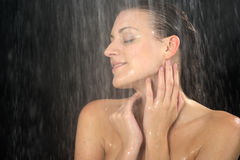 Woman standing at the shower Royalty Free Stock Photos