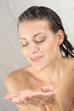Woman standing at the shower Stock Images