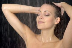 Woman standing at the shower Stock Photos