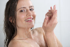 A woman standing at the shower Stock Image
