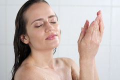 A woman standing at the shower Stock Photo