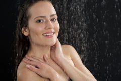 A woman standing at the shower Stock Photography