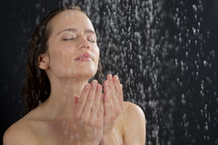 A woman standing at the shower Royalty Free Stock Photo