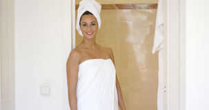 Woman standing at shower stall wrapped in towels royalty free stock photos