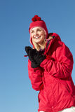Woman Standing In Snow On Ski Holiday Stock Photos