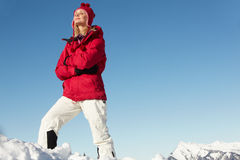 Woman Standing In Snow On Ski Holiday Royalty Free Stock Image