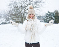 Woman standing in snow in winter Stock Image