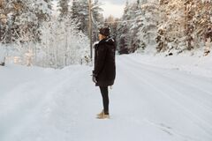 Woman standing in snowy landscape Stock Photo