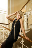 Woman standing on a staircase Stock Photos