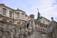 Woman standing on the stairs of the castle Stock Images