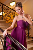 Woman standing on the stairs in the hotel lobby Royalty Free Stock Image