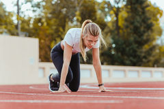 Woman standing in start position for run Royalty Free Stock Image