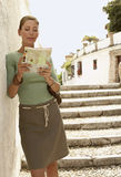 Woman Standing On Steps Reading Map Stock Image