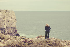 Woman standing on stone cliff Royalty Free Stock Images