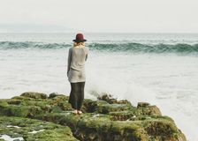 Woman Standing in Stone at the Sea Side Stock Image