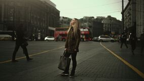 Woman standing in street Royalty Free Stock Photography