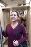 Woman standing in  subway car. Royalty Free Stock Photo