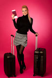 Woman standing with suitcases and travell documents excited to g Royalty Free Stock Image