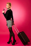 Woman standing with suitcases and travell documents excited to g Royalty Free Stock Photography
